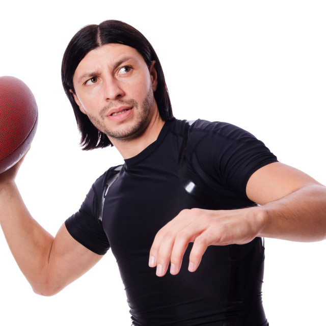 """Man training with american football on white"" stock image"