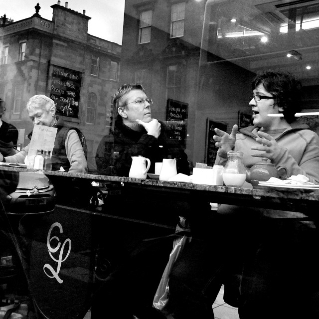 """COFFEE SHOP: Diners relax on window seats in a cafe on George IV"" stock image"