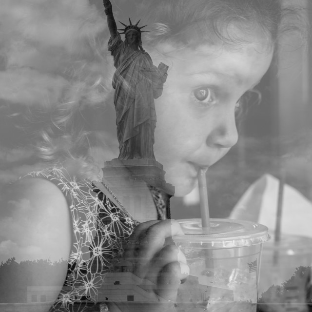 """Statue of Liberty, girl tourist"" stock image"