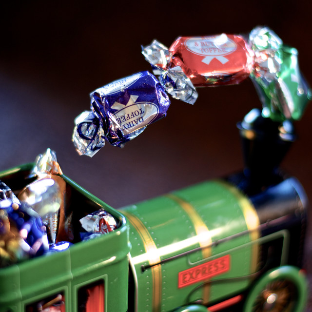 """""""The Toffee Express. Sweeties from the smoke stack of a toy train, full steam..."""" stock image"""