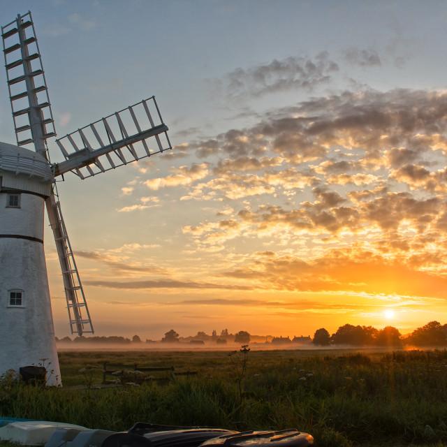 """Face The Dawn- Thurne wind pump sunrise"" stock image"