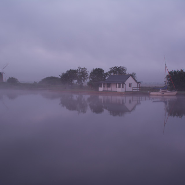 """""""St Bennets reflected-misty morning at St Bennets wind pump"""" stock image"""