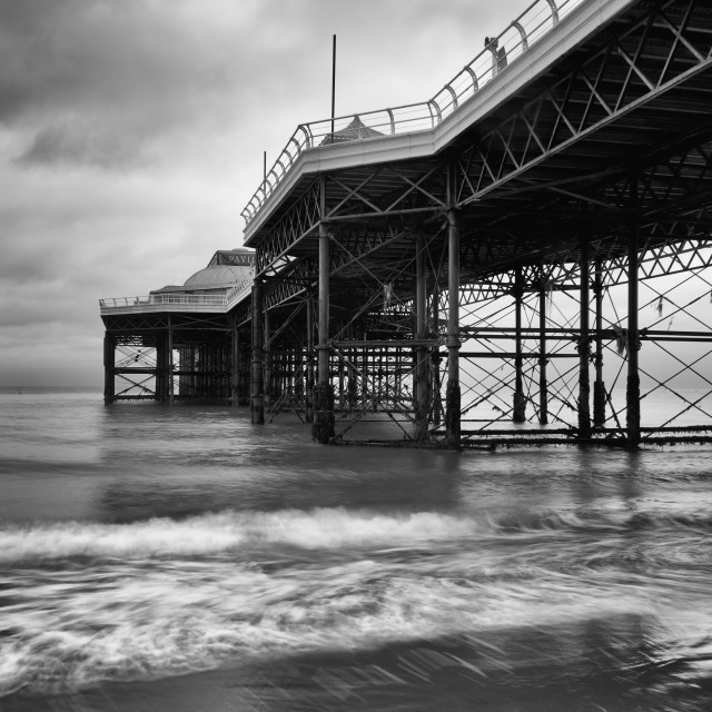 """""""Piering Out. Cromer pier mono with slow shutter speed"""" stock image"""