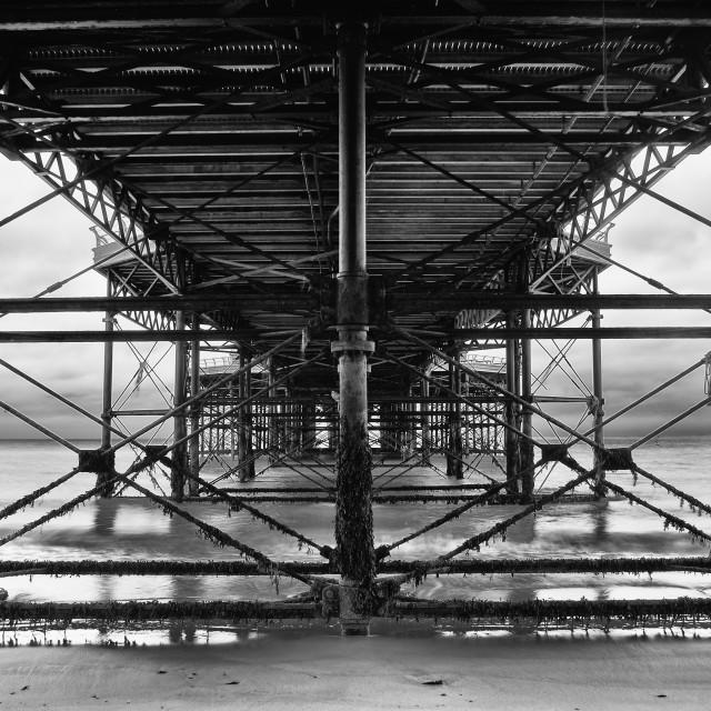 """""""Under The Boardwalk. Under Cromer pier mono"""" stock image"""