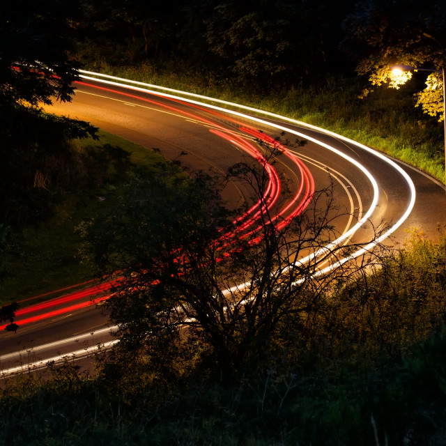 """""""red and white. Light trails round a bend in the road"""" stock image"""