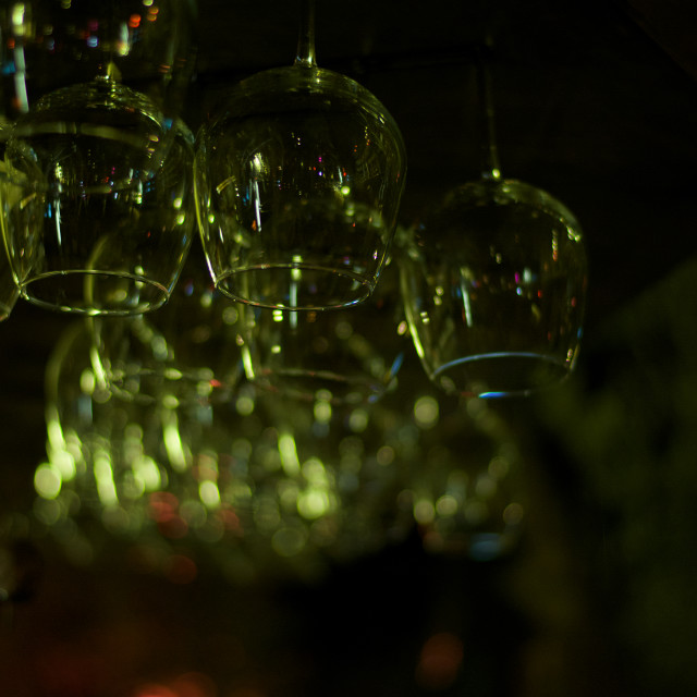 """Glasses hanging. .Wine glasses hanging up, in a garden bar-Turkey (Kalkan)"" stock image"