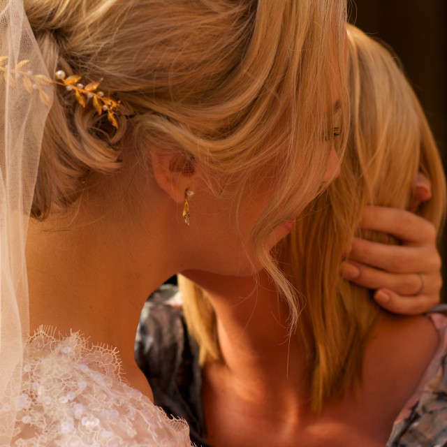 """Bride and friend-embracing"" stock image"