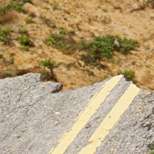 """""""End of the road. collapsed road with double yellow lines"""" stock image"""
