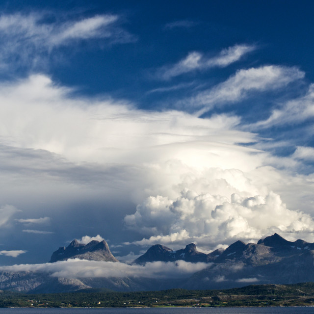 """""""Clouds over mountains"""" stock image"""