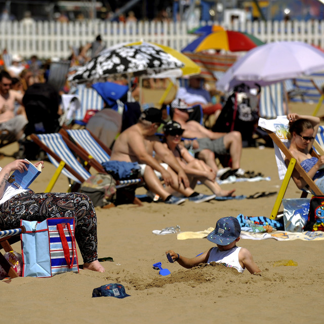"""Scarborough Sunbathers"" stock image"
