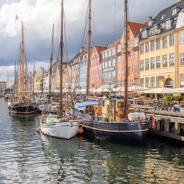 """Fihsing boats and colourful houses in Copenhagen harbour"" stock image"