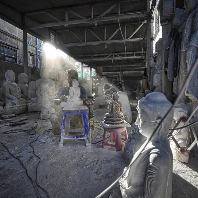 """A man doing the Buddha statue"" stock image"