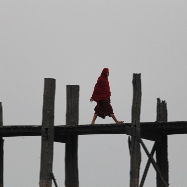 """a monk walking on wooden bridge"" stock image"