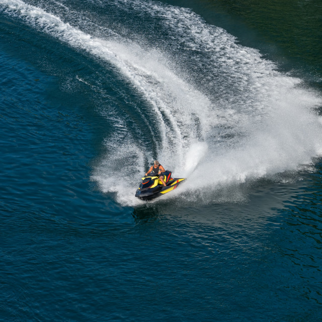 """Jet ski on a dark blue water"" stock image"