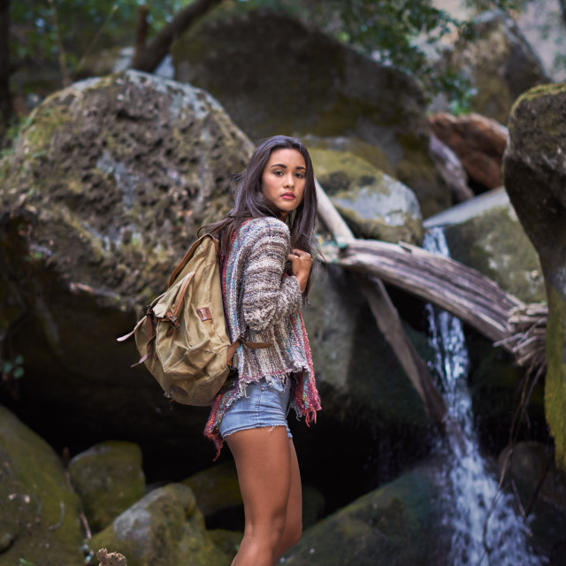 """Young Backpacker by a Waterfall"" stock image"