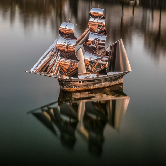 """Silver Ship at sunset"" stock image"