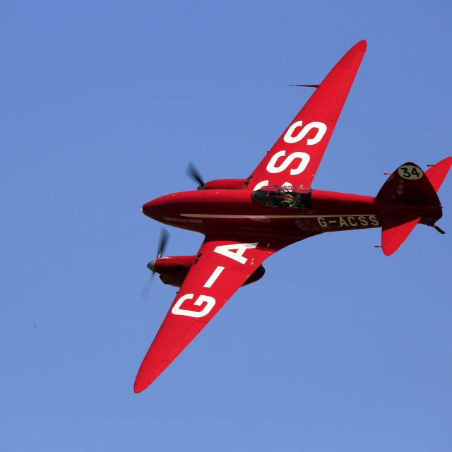 """""""De Havilland 88 Comet Racer in flight"""" stock image"""