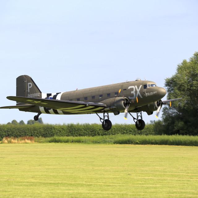 """Douglas C47 Dakota taking off"" stock image"