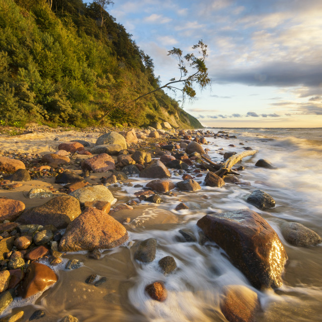"""""""Sea landscape at sunset, sandy beach and cliff,waves breaking on"""" stock image"""