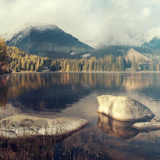 """beautiful autumn morning over a mountain lake Strbske Pleso,Tatra mountains,Slovakia.Toned with a retro vintage effect"" stock image"