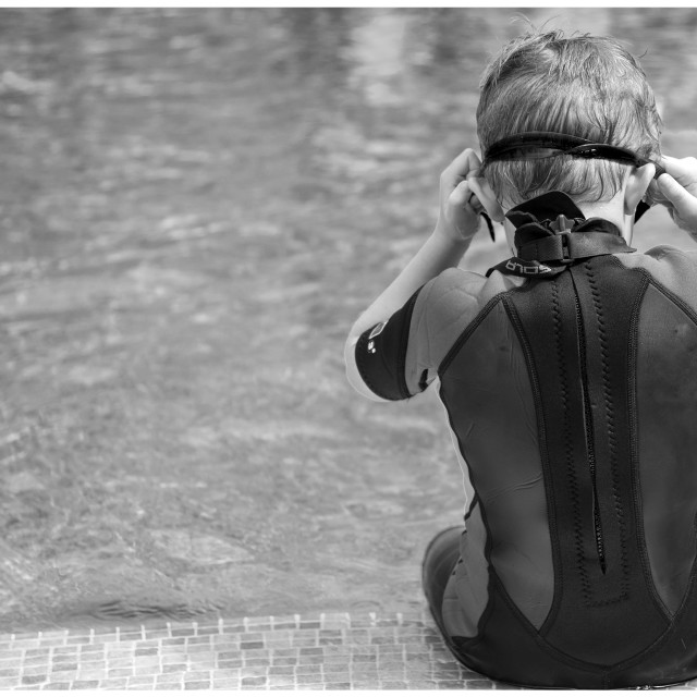 """""""Boy sat by a pool"""" stock image"""