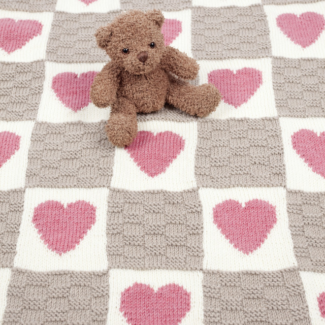 """Teddy Bear sat on rug"" stock image"