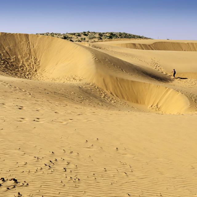 """""""A boy tourist walking on Sand dunes, SAM dunes of Thar Desert of"""" stock image"""