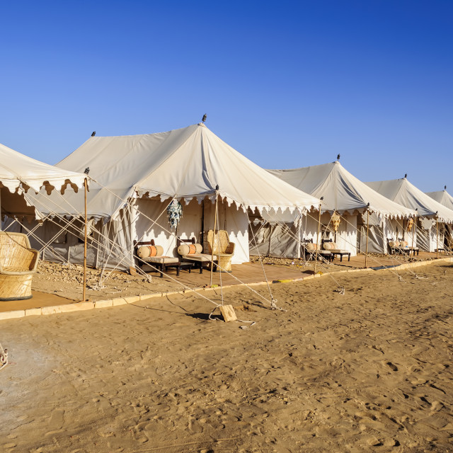 """A Desert Camp with tents and sitting arrangement, Copy Space"" stock image"