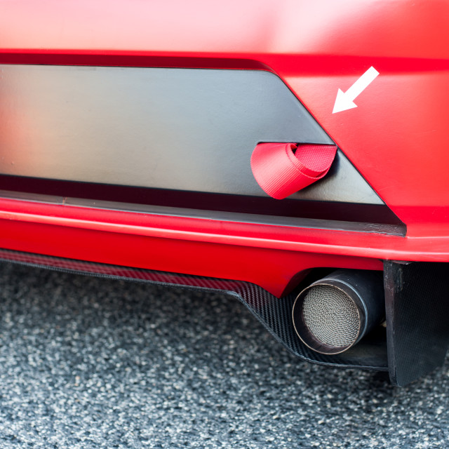 """Red sport car bumper and ribbon detail"" stock image"