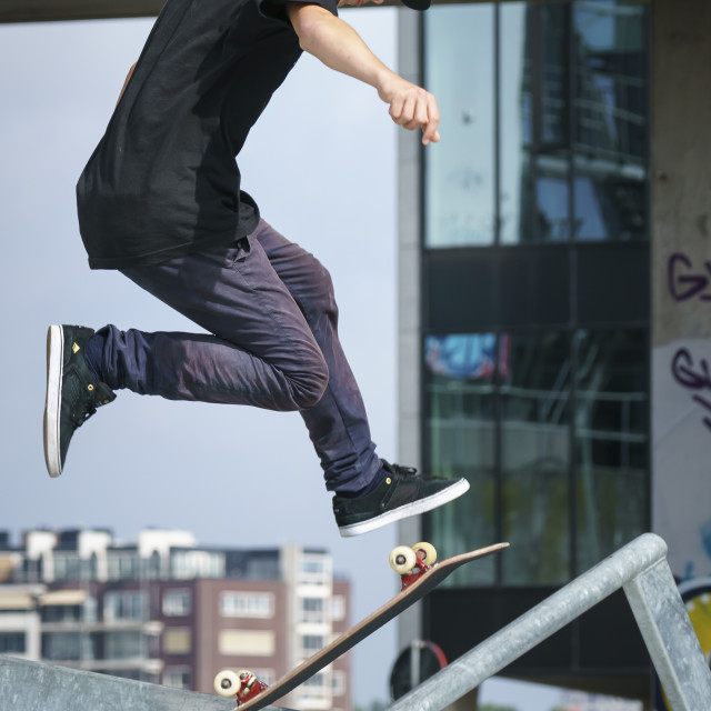 """High skateboard jump"" stock image"
