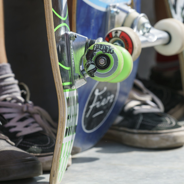 """DORDRECHT, NETHERLANDS - 3 SEPTEMBER 2016: Close-up of skateboard wheels and feet as teens hang out at the official opening of the new skateboard park in Dordrecht."" stock image"