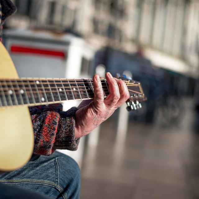 """Urban street musician playing guitar."" stock image"