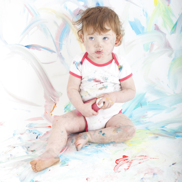 """red haired toddler playing with paint"" stock image"
