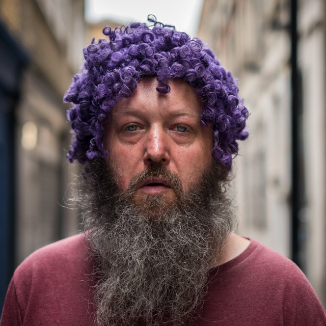 """Man with Purple Wig"" stock image"