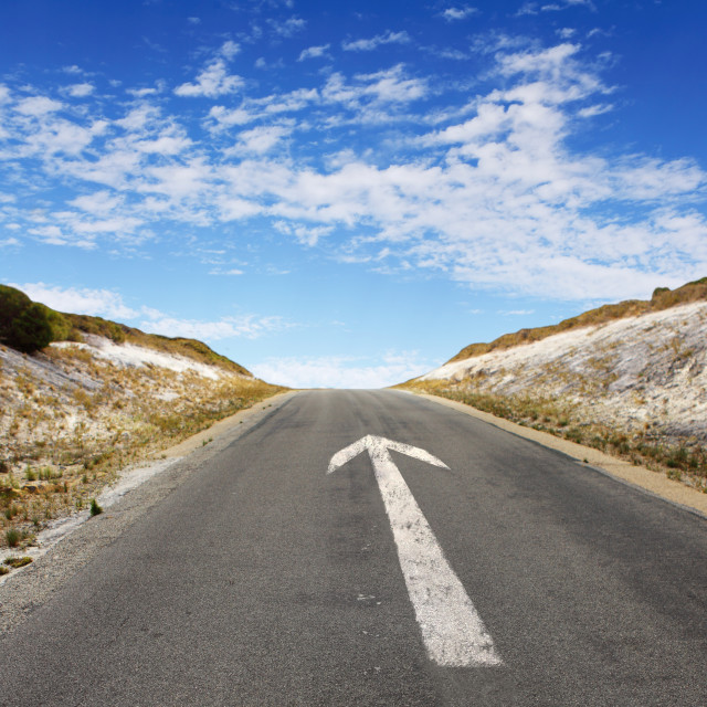 """""""Empty countryside road with white arrow"""" stock image"""
