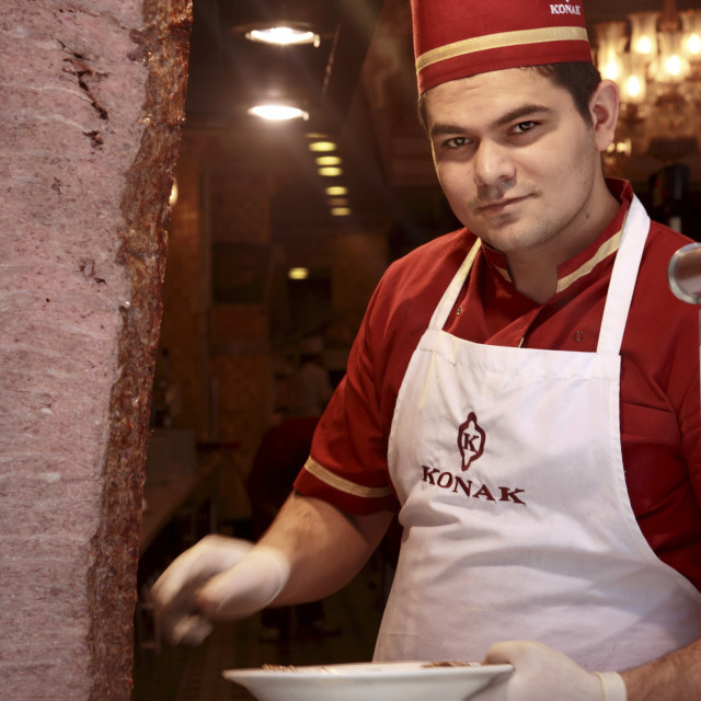 """""""Man slicing meat at The Konak Restaurant on Istiklal Caddesi in Istanbul Turkey"""" stock image"""