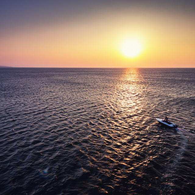 """Aerial view over Fishing boat on the water and beautiful sunrise"" stock image"