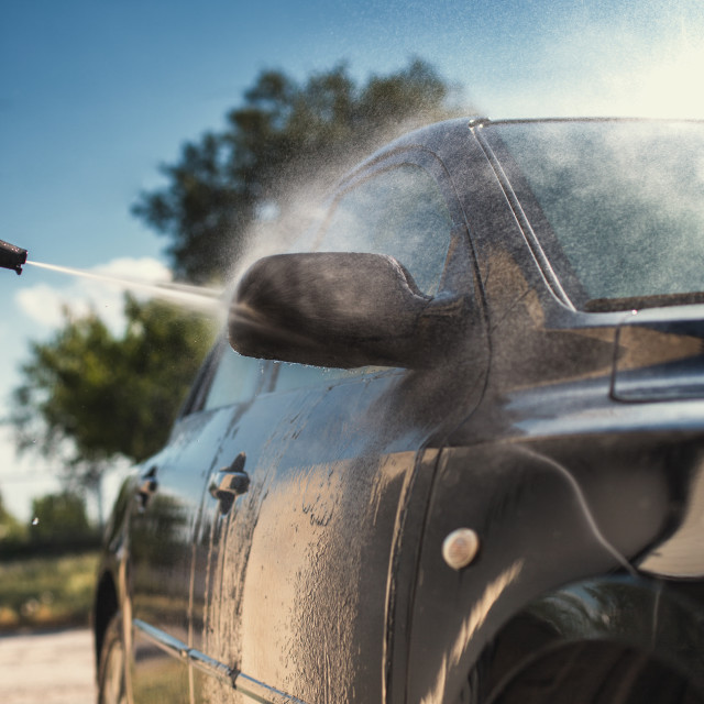 """""""Close up of nozzle of high pressure washer used on car"""" stock image"""