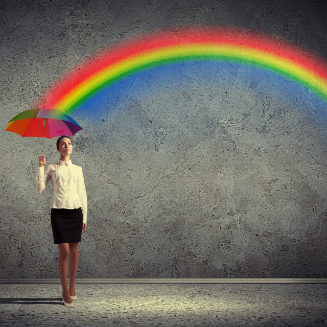 """""""Young business woman holding an umbrella"""" stock image"""