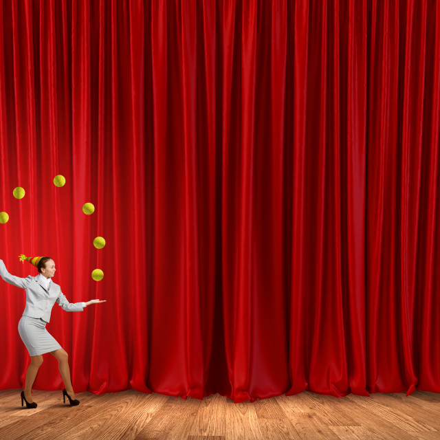"""Businesswoman juggling with balls"" stock image"