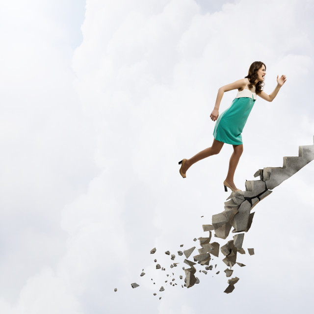 """""""Up the ladder overcoming challenges"""" stock image"""
