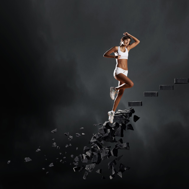 """""""Sports woman overcoming challenges"""" stock image"""