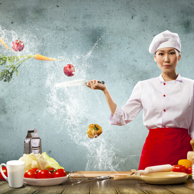 """Asian female cook with knife"" stock image"