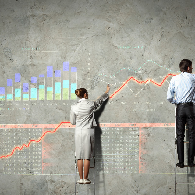"""businesspeople drawing diagrams on wall"" stock image"