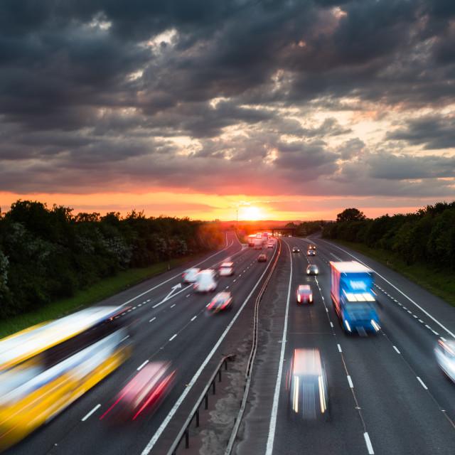 """Setting sun over motorway"" stock image"