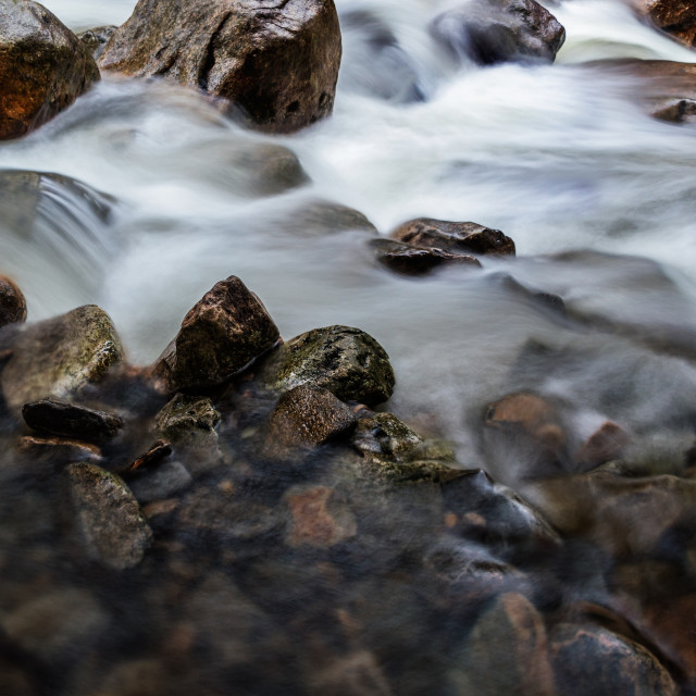 """Small stream with rocks"" stock image"