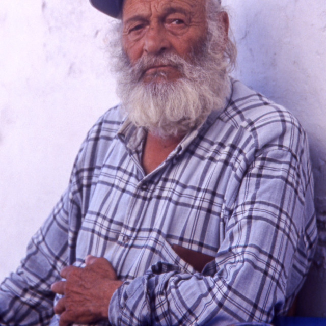 """Greece. Cyclades Islands. Amorgos. Old man sat at Langada village kafeneio."" stock image"