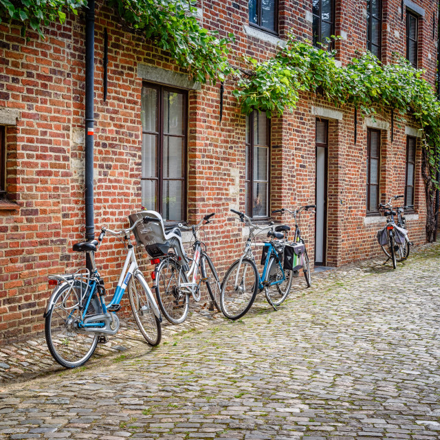 """Bicycles parked in an old house"" stock image"