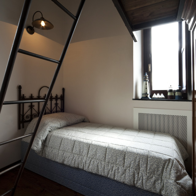 """""""Bedroom interior and wrought iron stairs"""" stock image"""