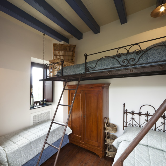 """""""Three beds room with wrought iron staircase"""" stock image"""